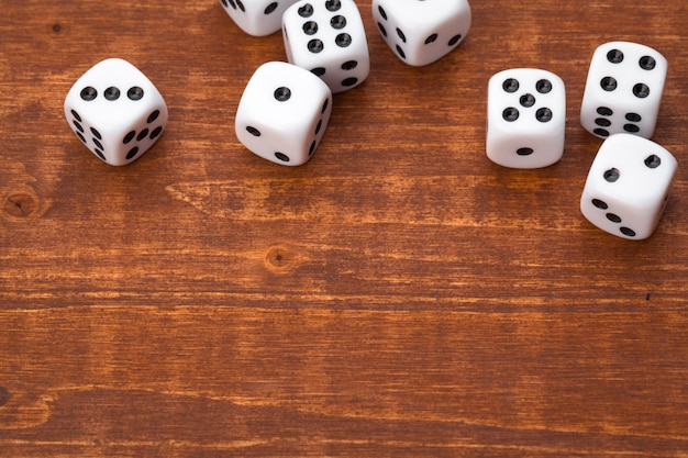 Dice on wooden table. for casino games. Premium Photo
