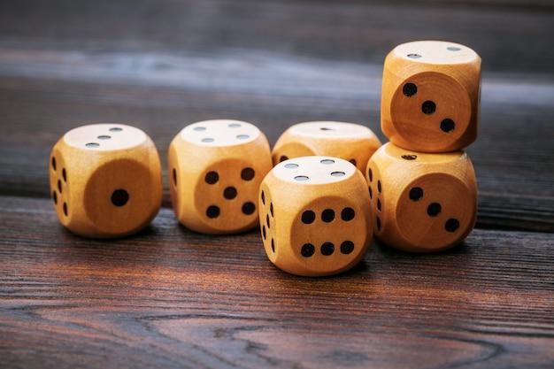 Dice on wooden table.   casino games. Premium Photo