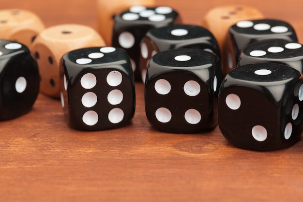Dice on a wooden table. concept for business risk. Premium Photo