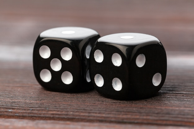Dice on wooden table. Premium Photo
