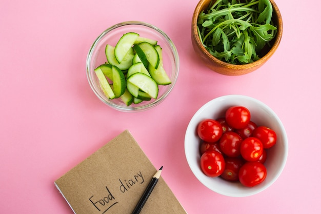 Diet concept. vegetables and food diary Premium Photo