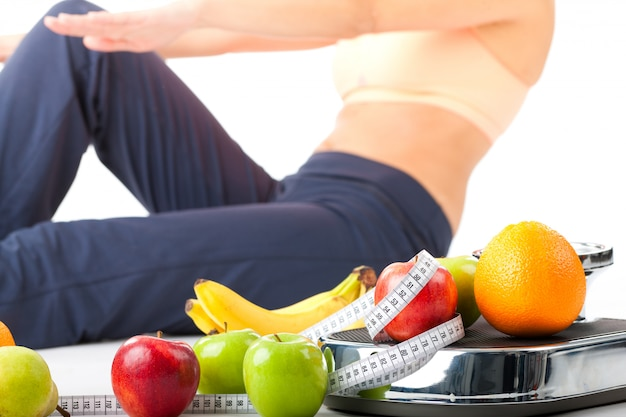 Diet and sport - young woman is doing sit-ups Premium Photo