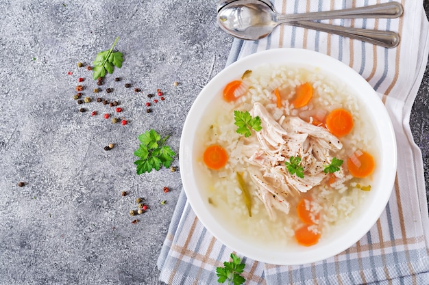 Dietary chicken soup with rice and carrots. Premium Photo