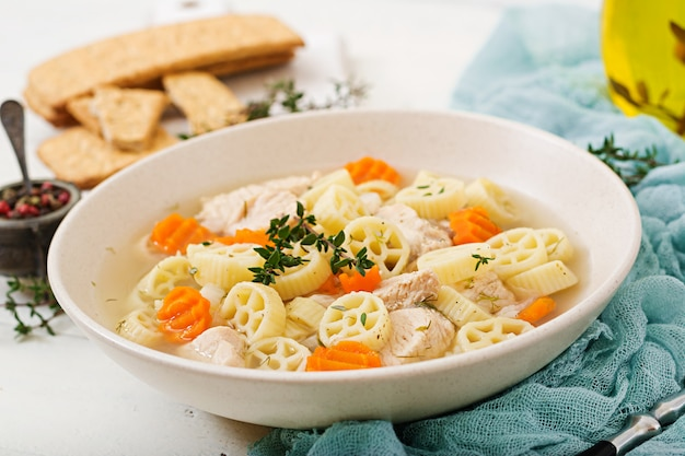 Dietary soup with turkey or chicken fillet with pasta ruote and herbs Premium Photo
