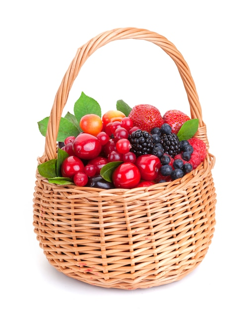 Different berries in basket on white background Premium Photo