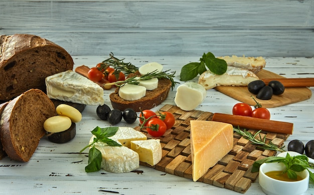 Different cheeses on table Premium Photo