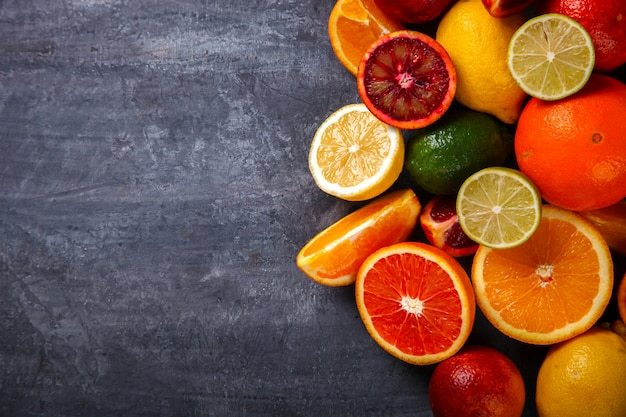 Different citrus fruit on a grey background Premium Photo