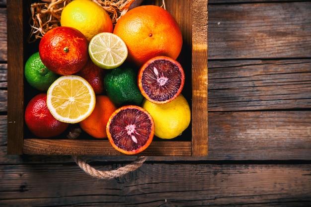 Different citrus fruit . summer background. Premium Photo