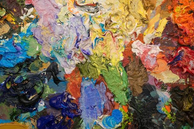 Different color oil paint. colorful, modern art ,oil paint background Premium Photo
