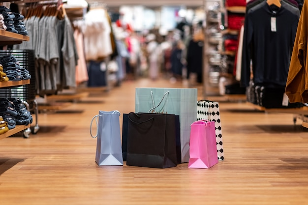 Different colored bags of different sizes are in one heap in the middle of the trading floor of the store. Premium Photo