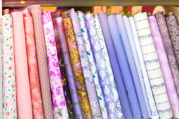 Different colored pills of cloth fabrics textile neatly folded for display Premium Photo