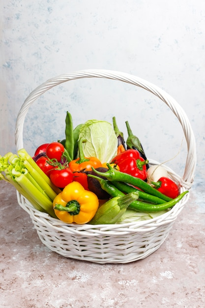 Different colorful fresh vegetables on concrete surface Free Photo