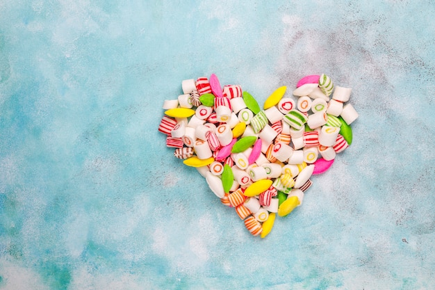 Different colorful sugar candies, top view Free Photo