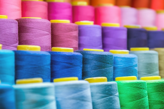 Different colors of thread, textile, for clothing manufacture Premium Photo