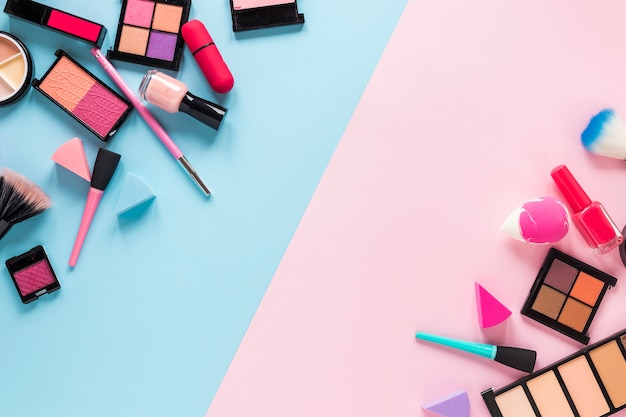 Different cosmetics scattered on bright table Free Photo