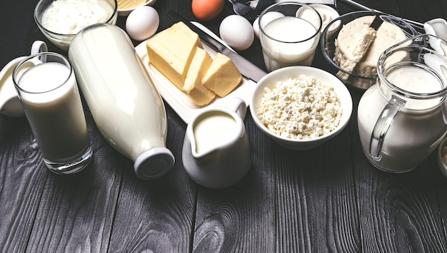 Different dairy products on black wooden table Premium Photo