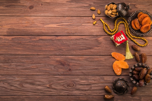 Different dried fruits and nuts with beads Free Photo