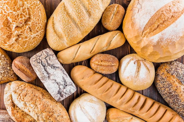 Different fresh baked bread on table Free Photo