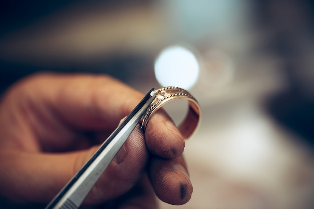 Different goldsmiths tools on the jewelry workplace. jeweler at work in jewelry. Free Photo