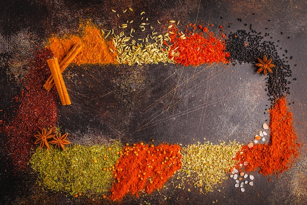 Different kind of spices on dark background. Premium Photo