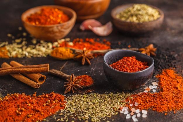 Different kind of spices on dark background. Premium Photo