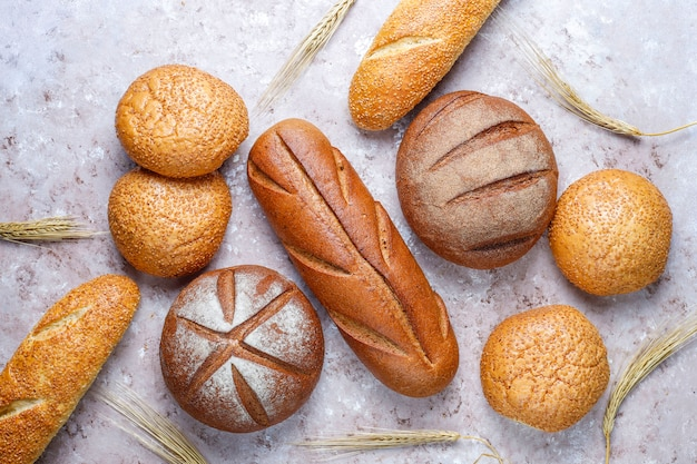 Different kinds of fresh bread as background, top view Free Photo