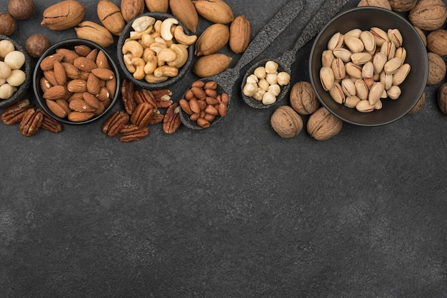 Different kinds of nuts on dark copy space background Free Photo