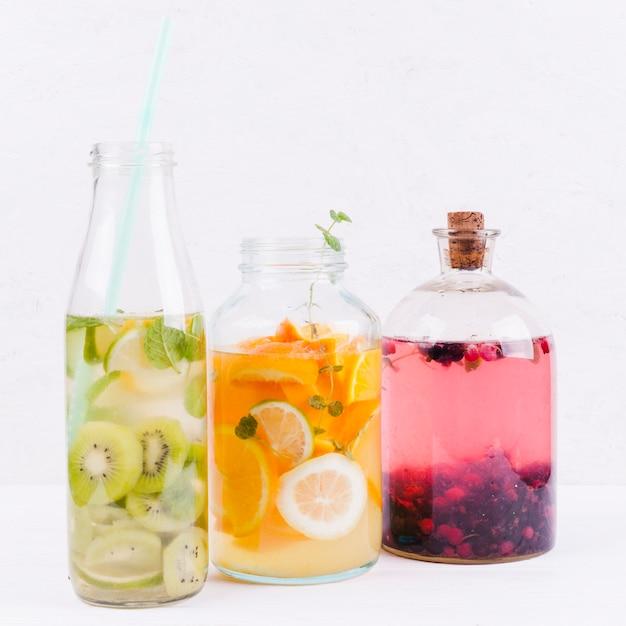 Different lemonade in bottles Free Photo