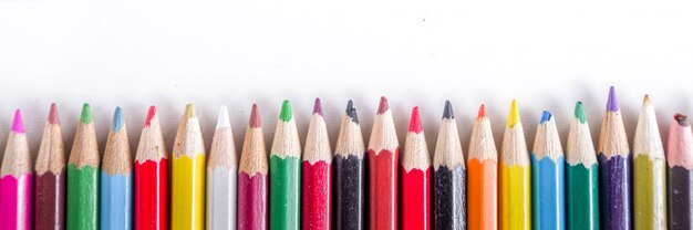Different multi colored pencils flat lay Premium Photo