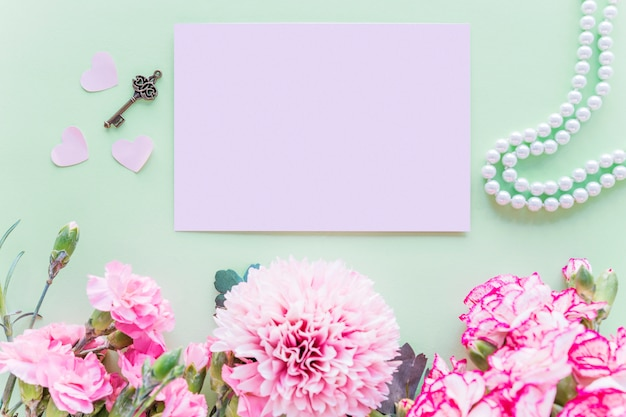 Different Pink Flowers With Paper On Green Table Photo Free Download
