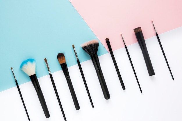 Different powder brushes on bright table Free Photo