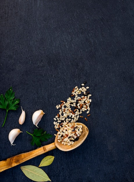 Different rice grains in wooden spoon Free Photo