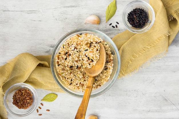 Different rice types in bowls with spoon on table Free Photo