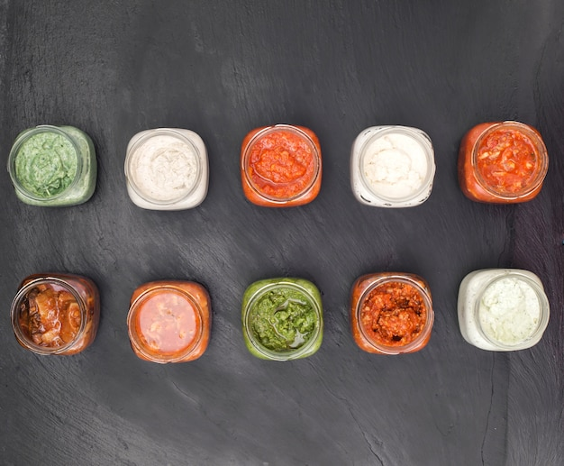 Different sauces in glass jar top view Premium Photo