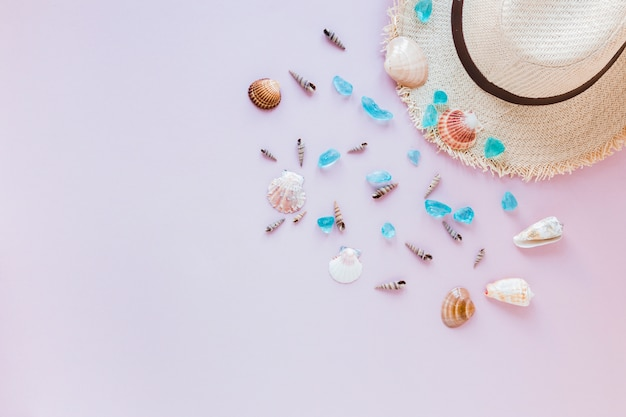 Different sea shells with straw hat Free Photo