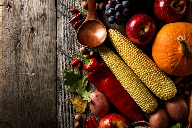 Different Seasonal Autumn Vegetables And Fruits On Wooden