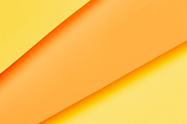 Different shades of orange papers close-up Free Photo
