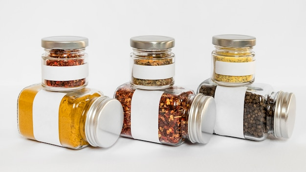 Different sized jars on white background Free Photo