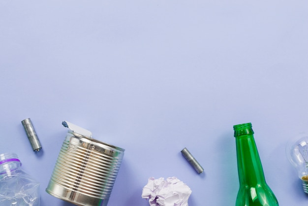 Different sorts of garbage for recycling on blue background Free Photo