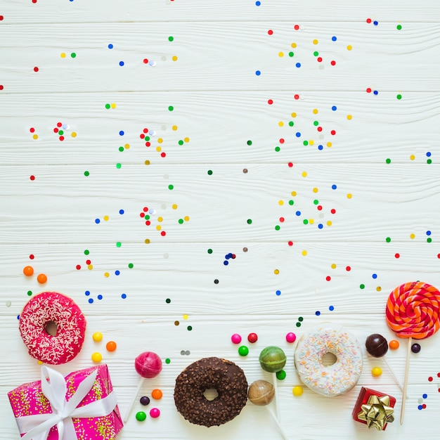 Different sweets and confetti Free Photo