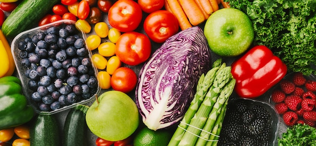 Different tasty vegetables on rough background Premium Photo