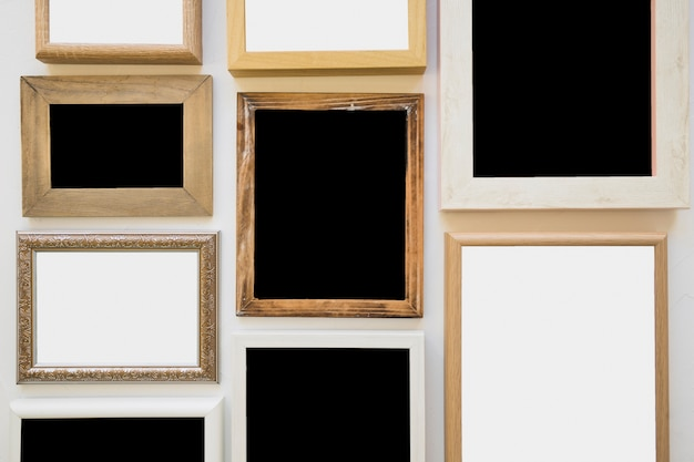 Different type of blank picture frame on wall Free Photo
