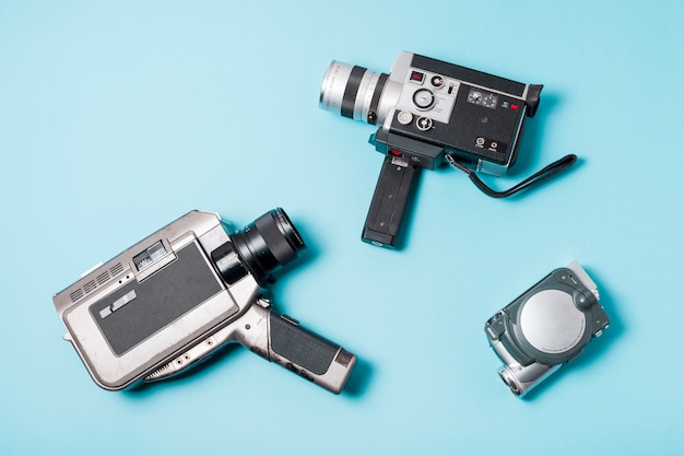 Different type of camcorder on blue background Free Photo