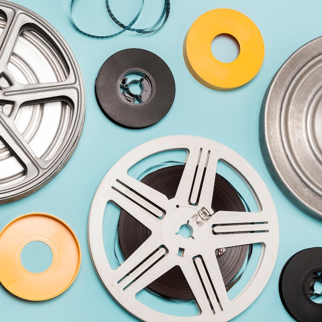 Different type of film reels against blue background Free Photo
