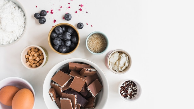 Different type of ingredients for making cake on white background Free Photo