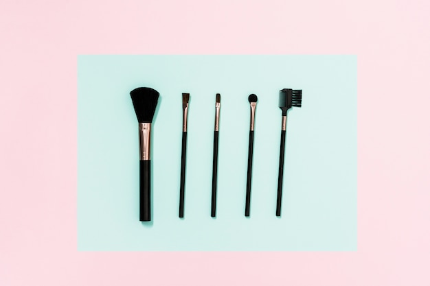 Different type of makeup brushes on dual background Free Photo