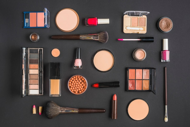 Different type of makeup products on black backdrop Free Photo