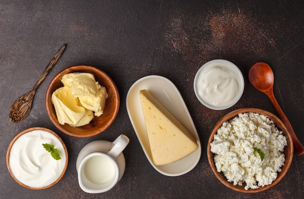 Different types of dairy products on dark background, top view, copy space. healthy food background. Premium Photo