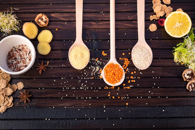 Different types of grains in spoons with rice Free Photo