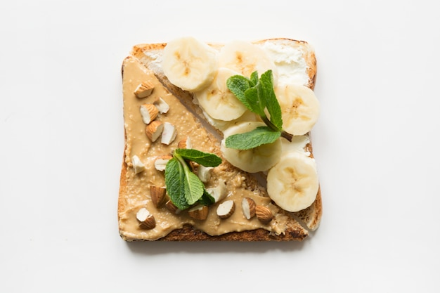Different types of sandwiches for healthy and sugar-free children's breakfast, nut paste, bananas. Premium Photo